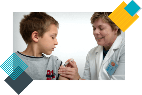 An experienced female pediatrician vaccinates a boy for health protection.